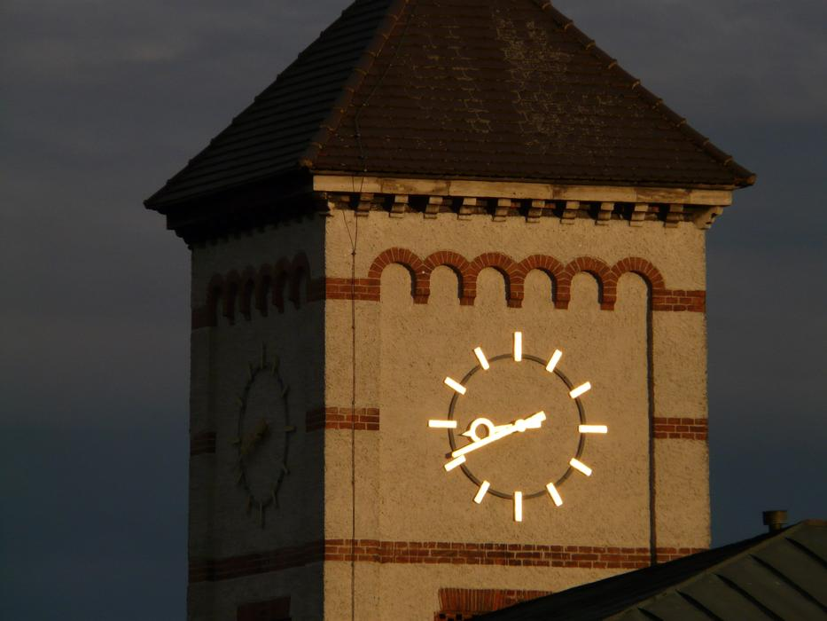 golden clock on tower