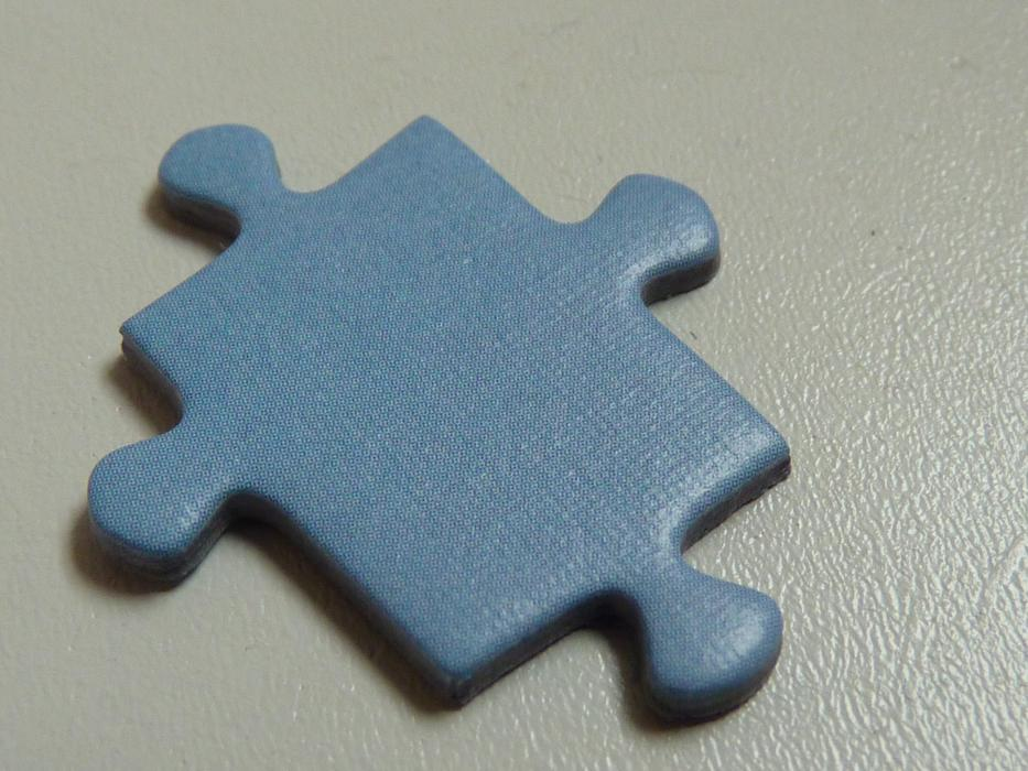 blue Puzzle Piece on grey surface