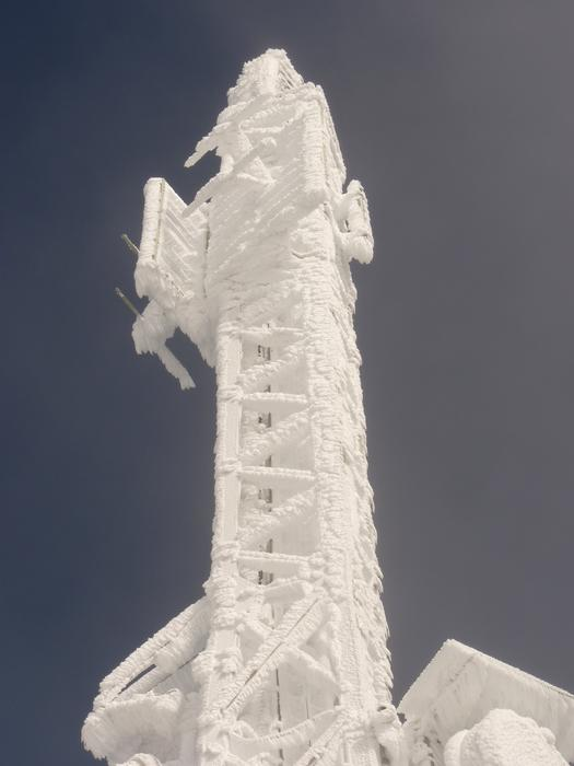 Beautiful ice tower at blue sky background in winter