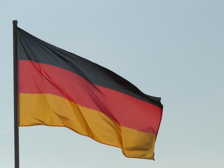 Flag of Germany winding at sky