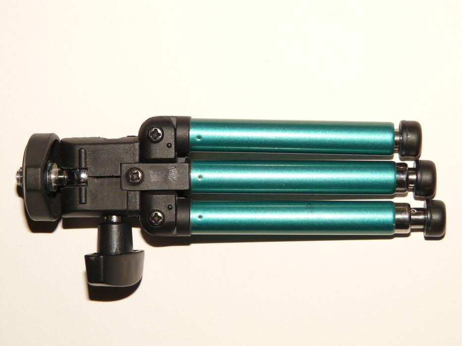 black green camera tripod