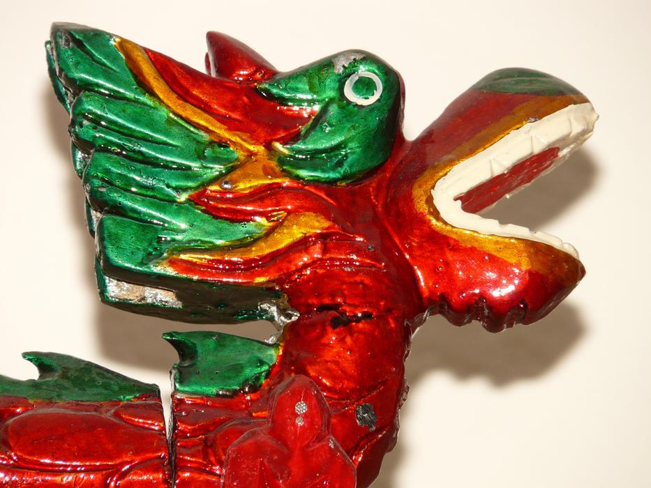 Beautiful green, red, orange and yellow Chinese dragon figure