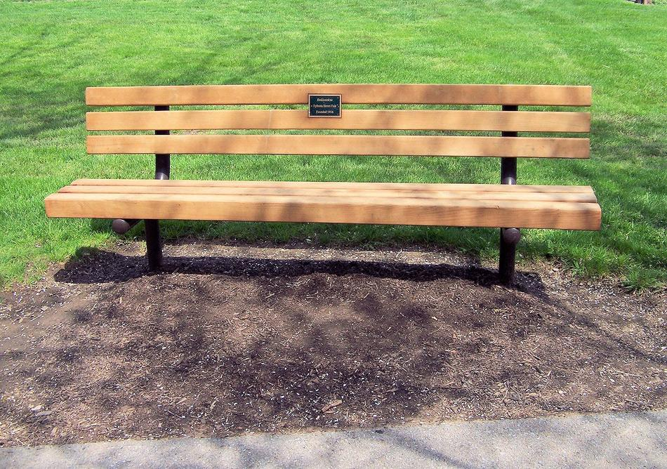 new wooden park bench