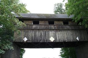 old Wooden covered Bridge at summer