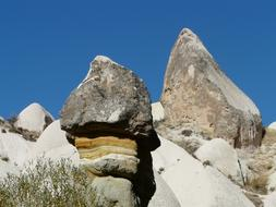Fairy tower rock formation on hill at sky, turkey, Cappadocia, Valley Of Roses
