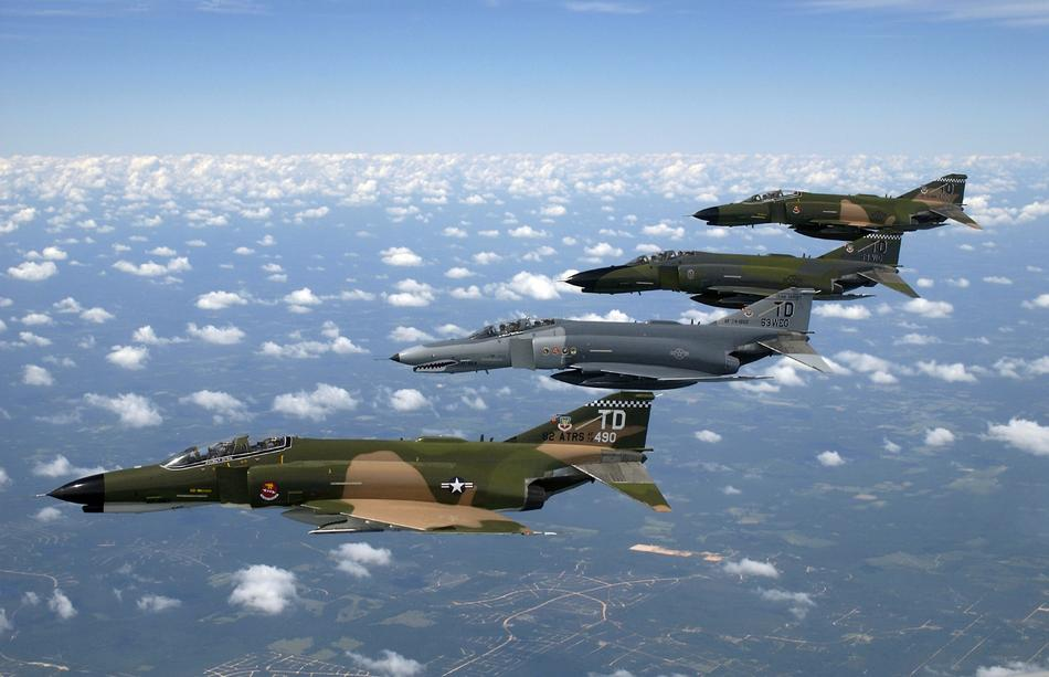 four us army Fighter Jets above clouds