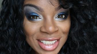 face of happy african woman with bright Makeup close up