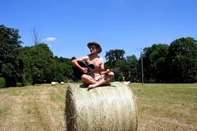 Guitar Player Musicia straw bales