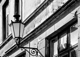 black and white photo of a street lamp on a historic building