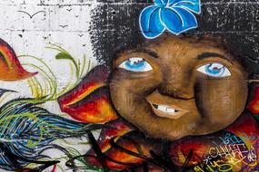 graffiti depicting a black child on the wall of a city building