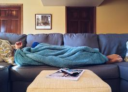 male person sleeps on sofa at home