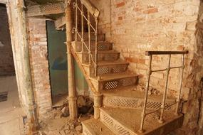 antique staircase in shabby house