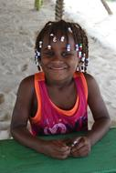 photo of a girl with African pigtails in the Caribbean