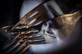 photo of a girl's face on a metal fork