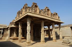 ornate stone carved pavilion in courtyard of Hazara Rama Temple, india, Hampi
