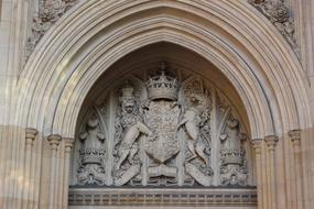ornate Coat Of Arms, stone carving on facade of historical building, uk, england, london