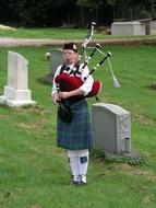 bagpiper in traditional clothes