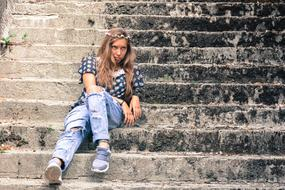 photo of a girl in jeans on the steps