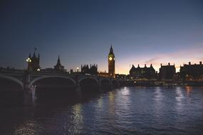 night photo of the bridge against the backdrop of Big Ben in London