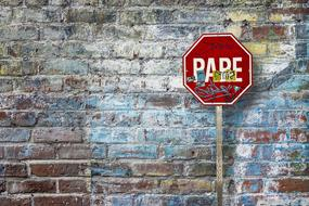 brick wall background with road sign