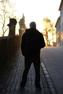 man silhouette in the city at sunset