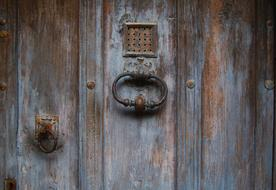 old wooden door with vintage metal handle