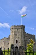 Flag on tower of medieval cardiff castle, uk, wales