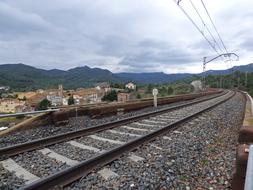 Railway near old town at cloudy day
