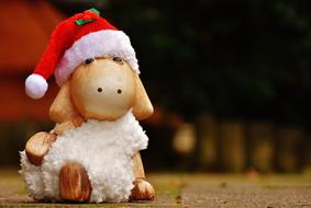 figurine of a sheep in a christmas hat