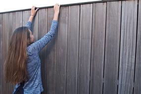 Girl Long Hair and wood fence