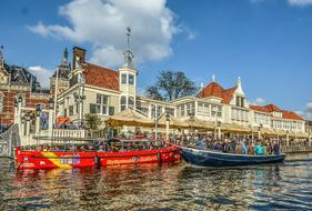 photo of bright tourist boats on a canal in Amsterdam