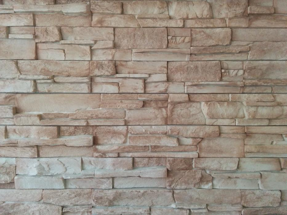 beige stone wall close up
