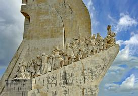 Monument to the Discoveries at sky, human sculptures, Portugal, Lisbon