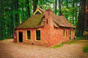 old brick house in a forest in the Netherlands
