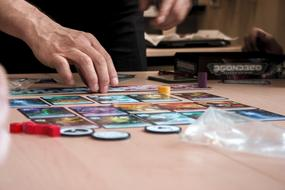 hands of senior woman at Board Game