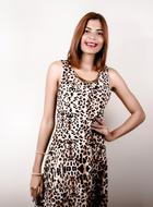 attractive young woman posing in dress with animal print