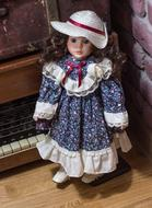 vintage doll stands by retro radio
