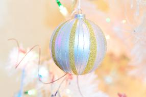 silver and golden christmas ball