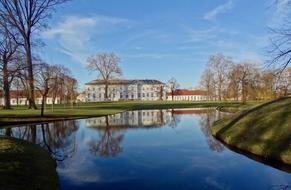 distant view of Neuhardenberg Palace in garden at pond, germany, Brandenburg