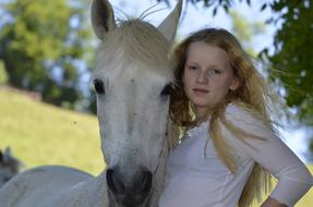 blond girl and white horse