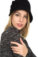 photo of blonde in a gray sweater and black hat