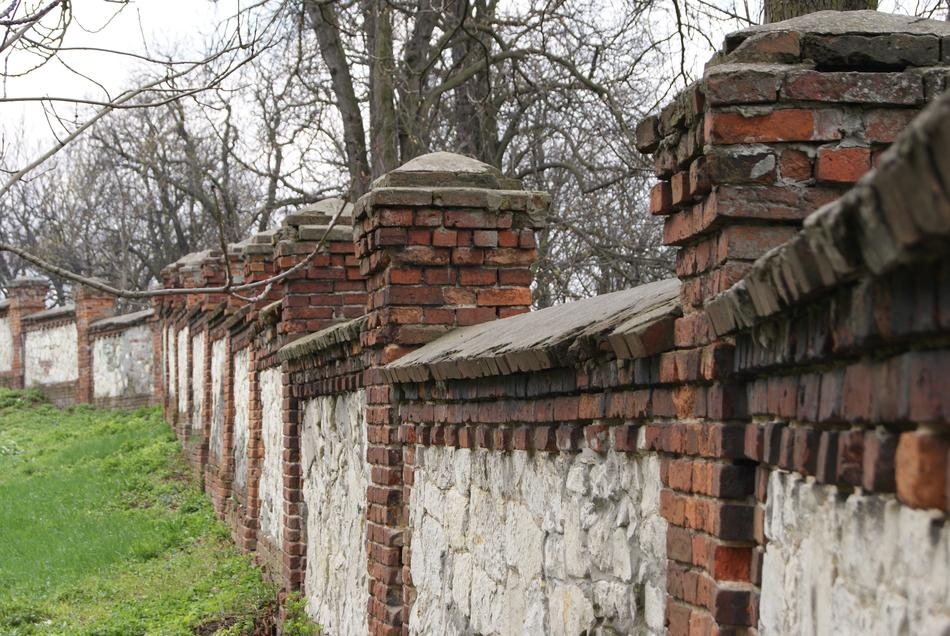 old brick fence near trees