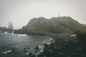 scenic rocky coast on foggy weather