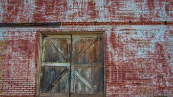 wooden door in an old brick hangar