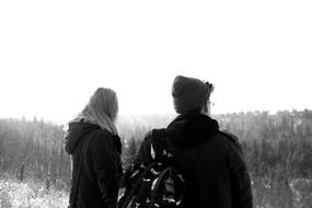 Guy and Girl in winter clothing, back view