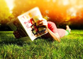 Person Reading Laying grass