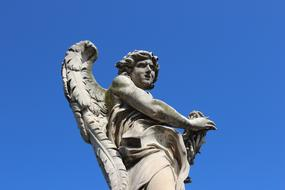 Angel monument and blue sky in Roma