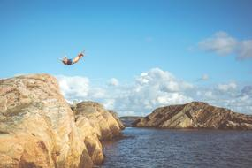 Man jumping cliff