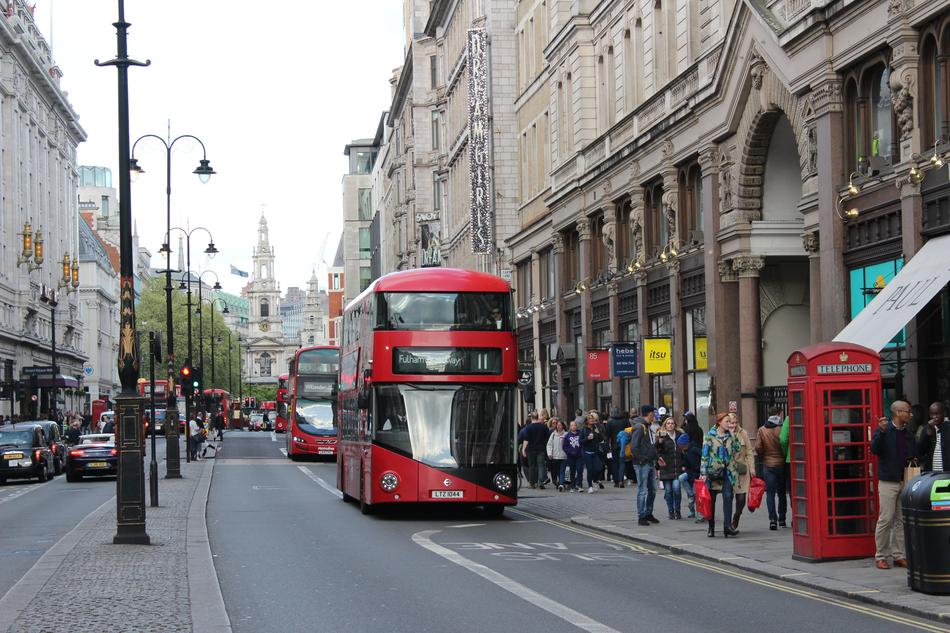 London Shopping street and red bus