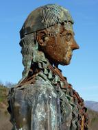 rusty metal female sculpture in the Pyrenees